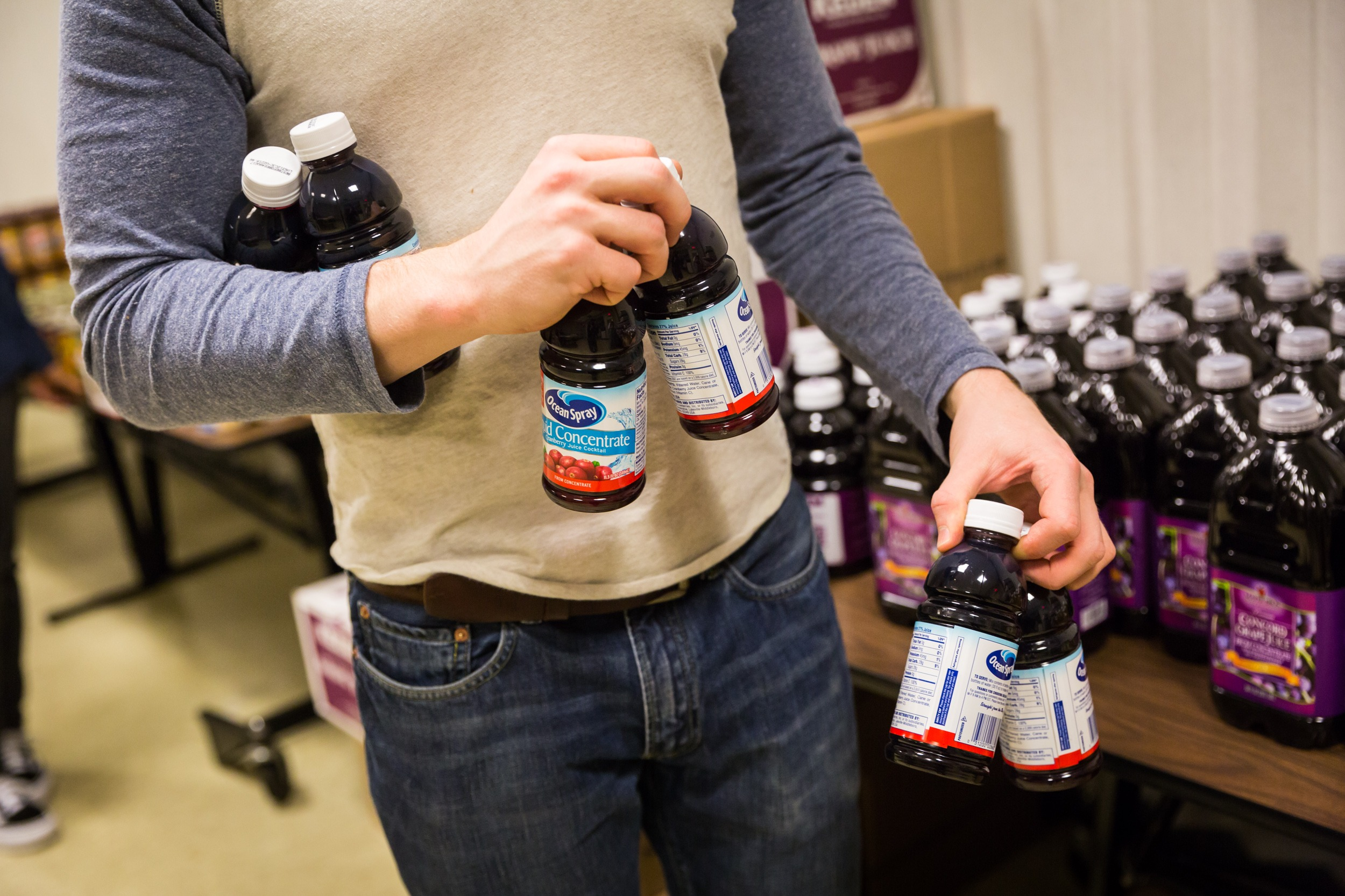 person holding bottles of cranberry juice