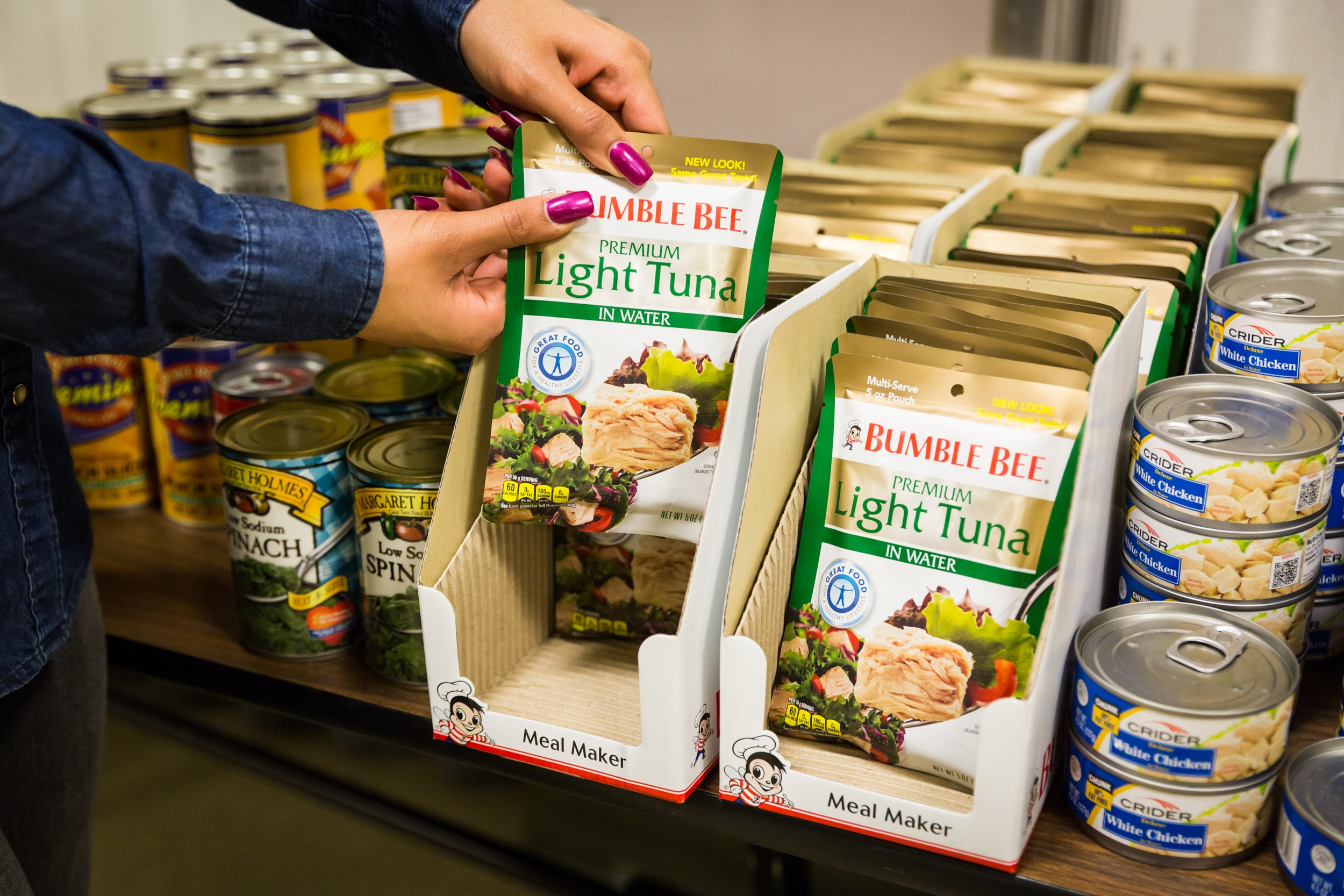 packages of tuna and cans of chicken