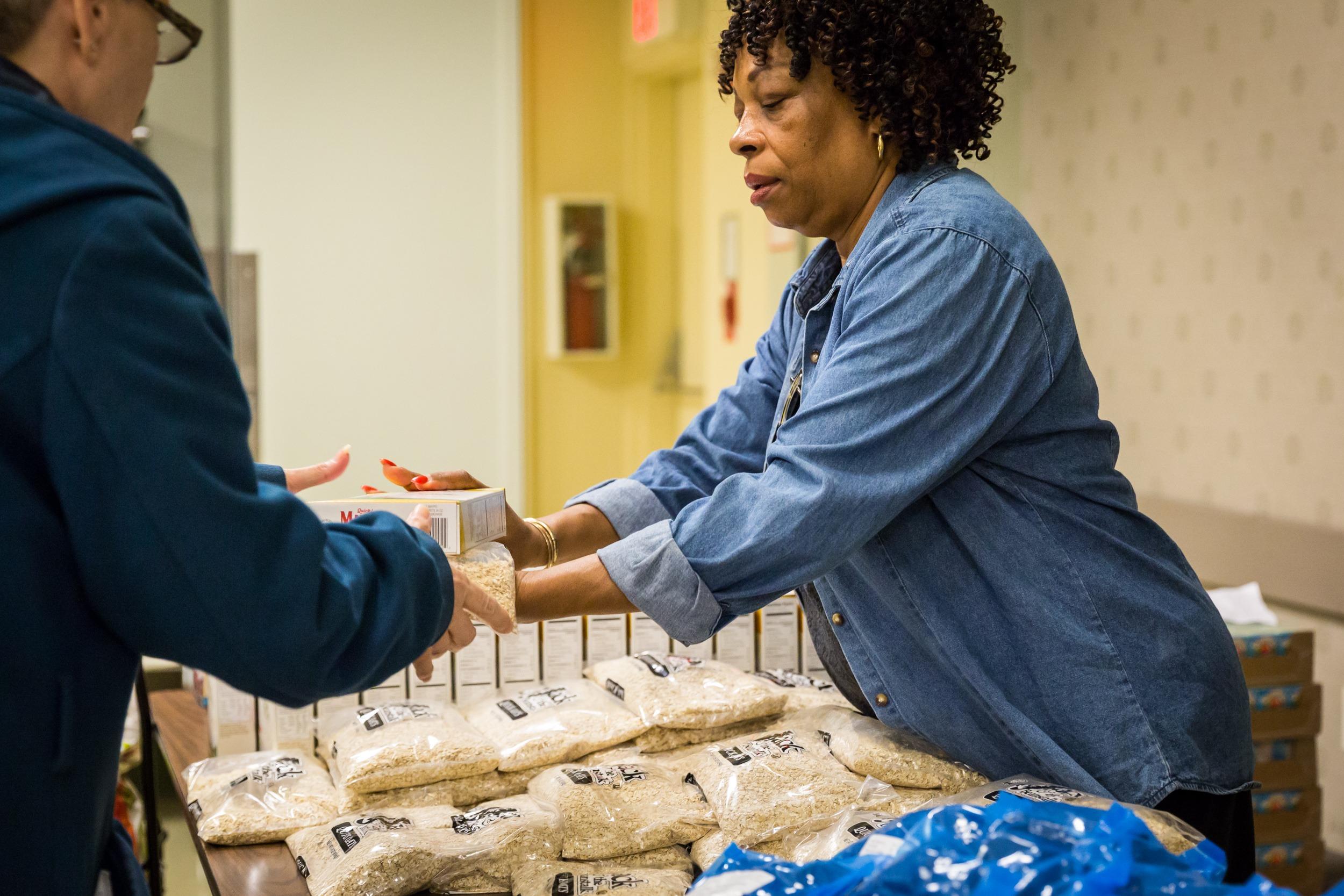 food pantry volunteer handing out food